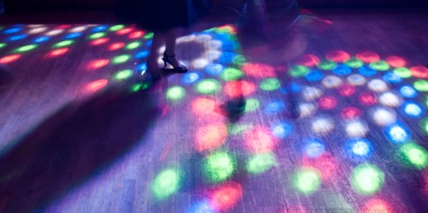 Costs-cropped-dancing-slow-shutter-lights-abstract-music-bunting-wedding-party-reception-london-uk-photographer-wed-married-photography-rob-cartwright.jpg