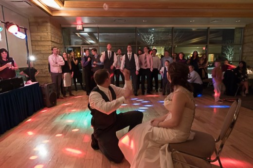 eagan_community_center_amy_minnick_bride_groom_garter_toss_lights_dj